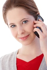 Portrait of young woman on mobile smiling