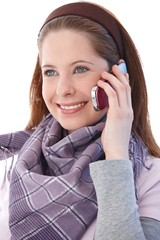 Attractive girl on mobile smiling