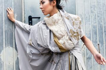 Modern fashionable woman over gray