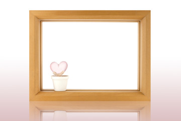 wood frame and crstal heart  on white background with reflection