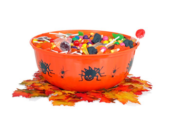 halloween candy in a bowl with fall leaves