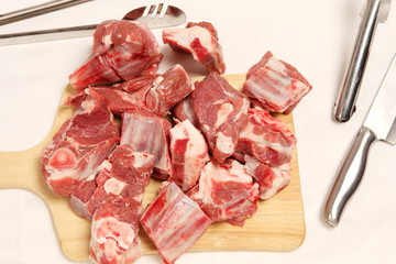 Freshly cut lamb meat on chopping board