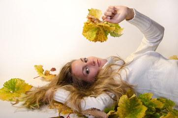 Autumn Beauty relaxed lying between grape leaves