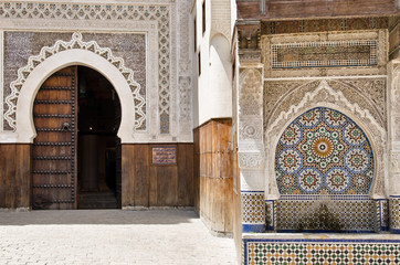 Decorated door and fountain in Fez