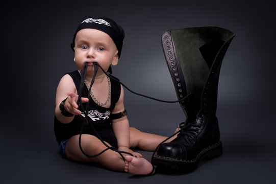 dark portrait of  rocker-baby on a black background