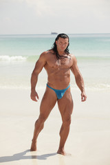 Bodybuilder by the shore