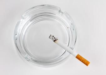 Glass ashtray and cigarette