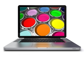 Laptop mit Farbdosen