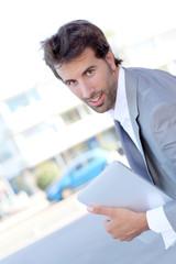 Portrait of cheerful businessman