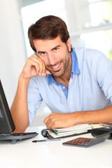 Portrait of happy office worker