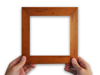 Hands holding empty wooden picture frame