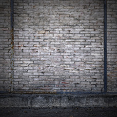 Old brick wall in an abandoned factory