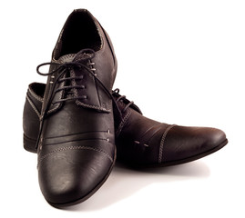 Black male shoes over white
