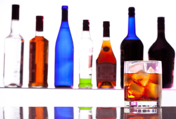Alcohol drink with bottles on the background