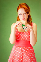 Pin-up style girl holding a bottle
