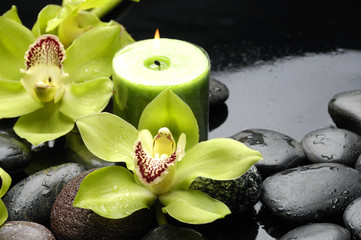 Tuinposter Spa burning candle and zen stones with yellow orchid