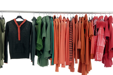 fashion autumn clothing on hangers