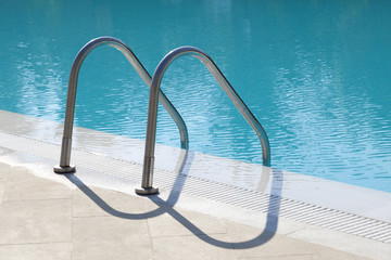 Metal stairs into a swimmingpool