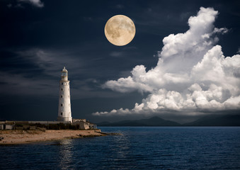 Fotobehang Volle maan lighthouse at night.