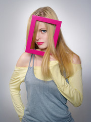 young woman shows a blond hair through a  frame