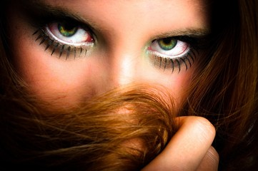 Woman hiding behind her hair