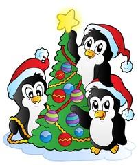 Three penguins with Christmas tree