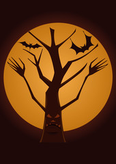 Spooky tree with the full moon behind