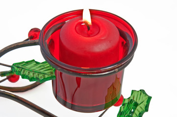 Red Votive Christmas Candle Burning in Holder
