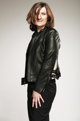 Happy middle-aged woman in black jacket.