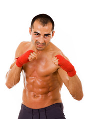 Portrait of young boxer man over white background