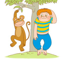little boy shows the monkey