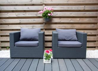 comfortable design furniture in a modern garden with summer flow