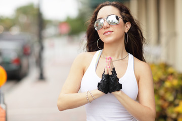 Woman with sunglasses praying