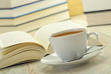 Books and cup of coffee on the table