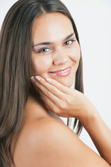 Closeup portrait of a happy young woman smiling.