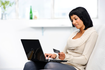 Woman making online reservations