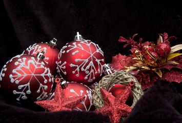 Red theme Christmas decorations against dark velvet background