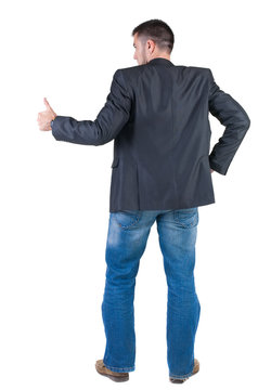 Businessman thumbs up. rear view.