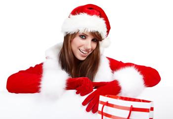 Beautiful christmas woman in santa hat holding empty board