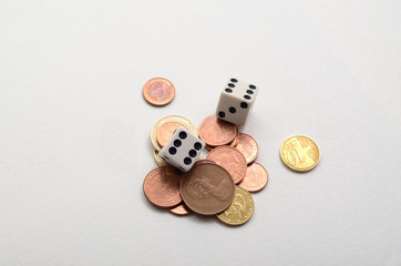 Dice with stack of gold and silver coins