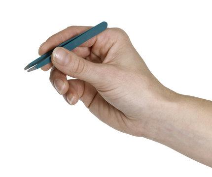 hand and tweezers