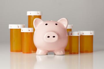 Piggy Bank In Front of Several Medicine Bottles