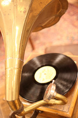 An antique phonograph with vinyl record.