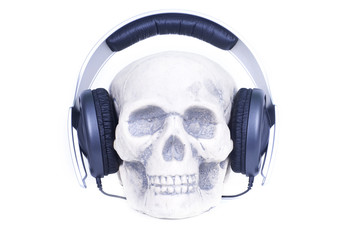 Human skull with music headphones.