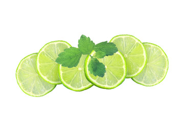 Fresh juicy lime slices and mint leaves isolated on white