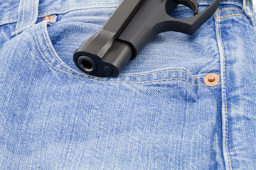 Weapon barrel coming out of jeans pocket