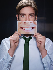 businessman with big mouth smiling at camera