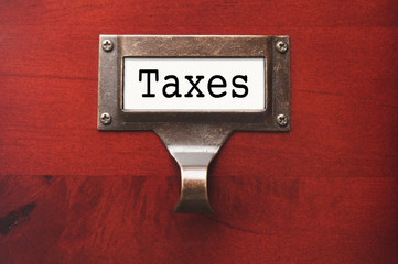 Lustrous Wooden Cabinet with Taxes File Label
