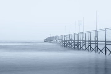 dock in the fog in winter with nobody