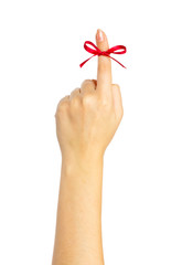 Red bow on finger